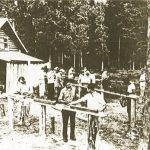 While the power chainsaw is now widely used, the two-man crosscut saw still has its place in the woods.  Here a group of students receive training in saw filing.