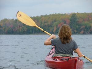 woman paddling a canoe