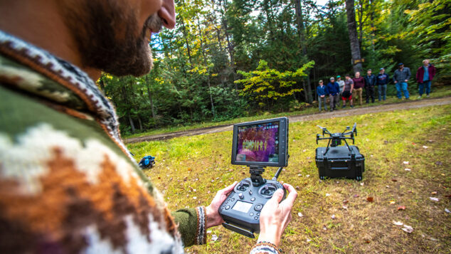 Dan Hayes takes his forestry class out into the Demeritt Forest to conduct a drone demo.